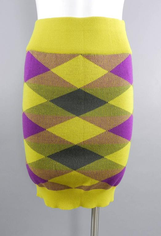 "Issey Miyake vintage 1980s Yellow and Purple Sweater and Skirt Set.  Stretchy knit tube skirt with ribbed waist and hem and asymmetrical neckline on sweater. Tagged size M (approximate USA 6/8). Stretchy but recommended for about 26-30"" waist,"