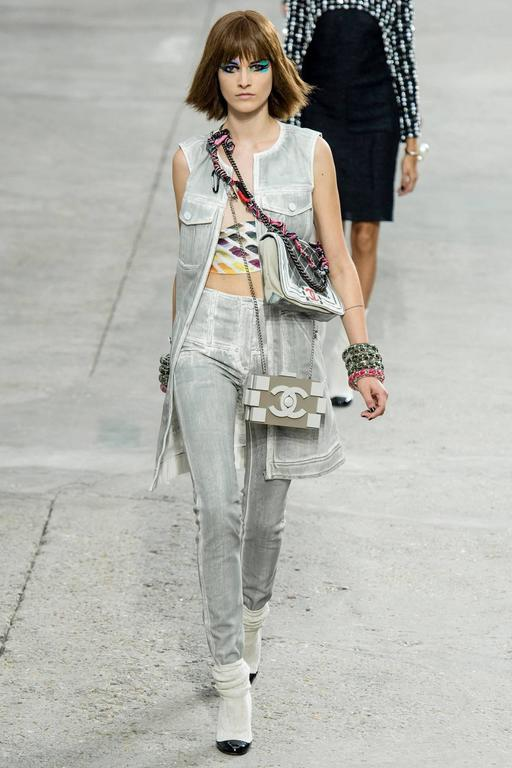 Chanel 2014 spring runway grey distressed denim long vest.  Light grey version was shown on the runway. Original retail price tag of $4600. Matching jeans are available in separate listing.  White denim base with dark charcoal grey.  Garment zippers