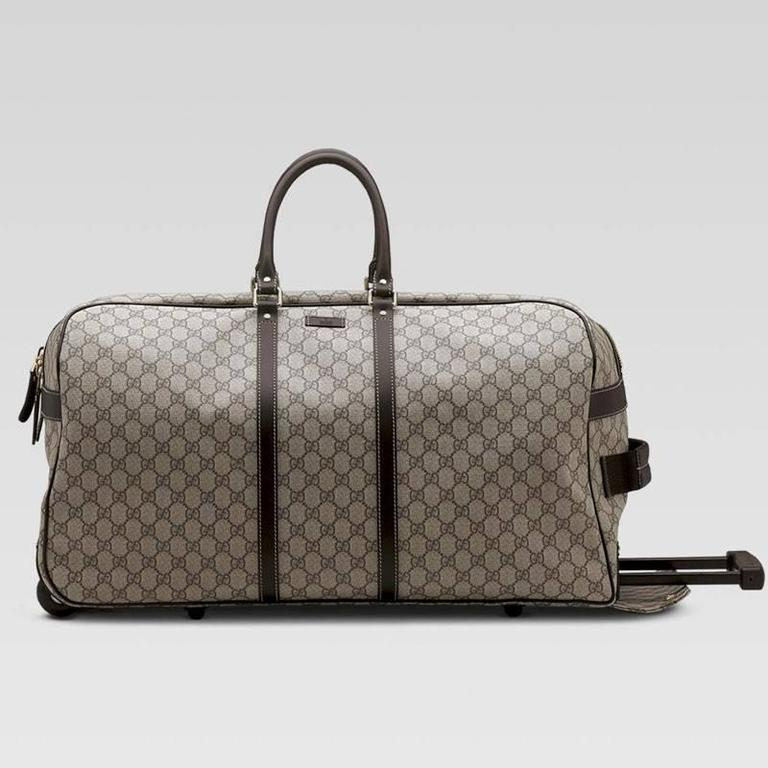 09c4b1e21 GUCCI GG monogram Brown Canvas Duffle Rolling Luggage Carry on Travel Bag.  Wheels on bottom