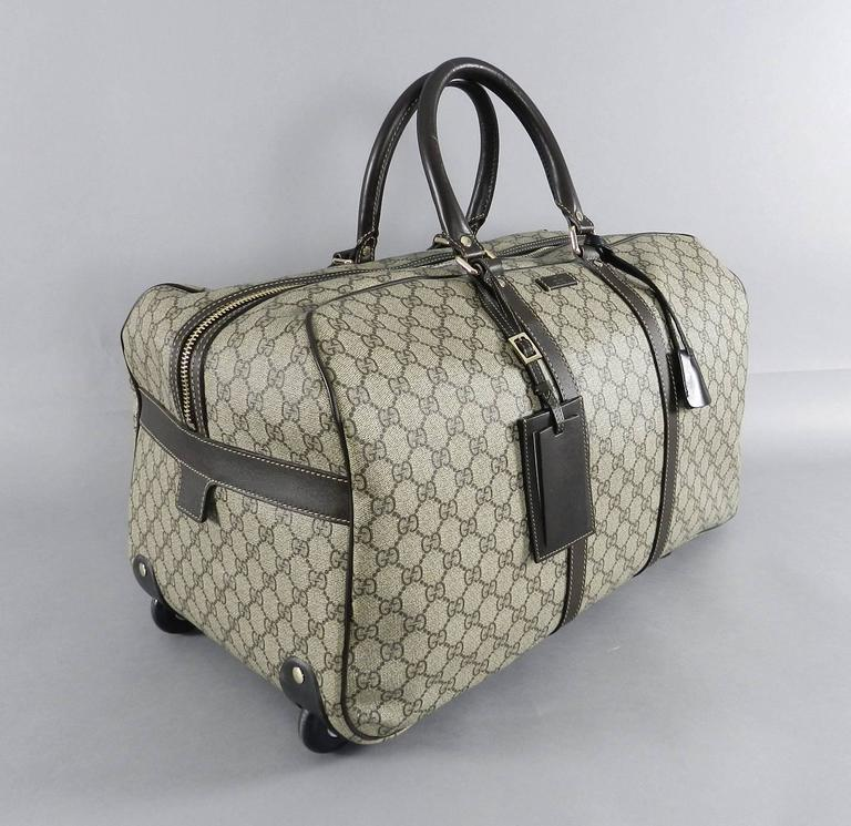 1b2ffaa4a Gucci GG monogram Brown Canvas Duffle Rolling Luggage Carry on Travel Bag  In Excellent Condition For