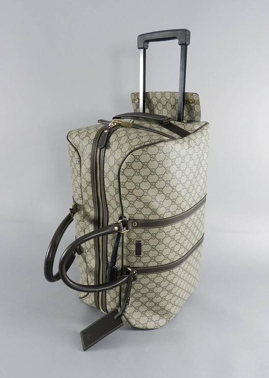 ac26c2db5d8 Gray Gucci GG monogram Brown Canvas Duffle Rolling Luggage Carry on Travel  Bag For Sale