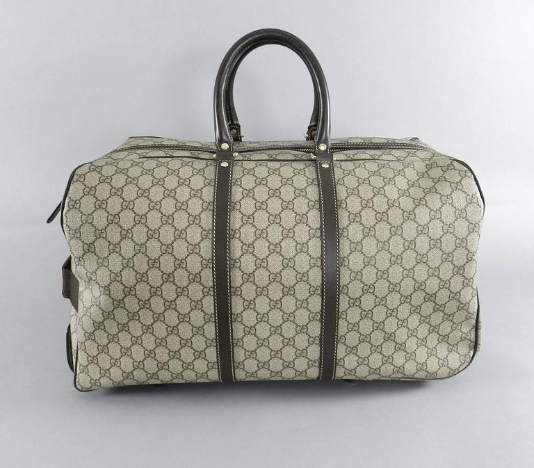 3e51858056df Gucci GG monogram Brown Canvas Duffle Rolling Luggage Carry on Travel Bag  For Sale 1