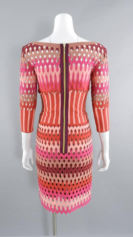 """ALAIA red and pink cut out diamonds bodycon stretch dress.  Gold centre back zipper, 3/4 length sleeves, fitted silhouette. Size small (USA 4/6). To fit 34/35"""" bust person, about 27"""" waist, 36"""" hip, 15.5"""" shoulder seams, 17"""""""