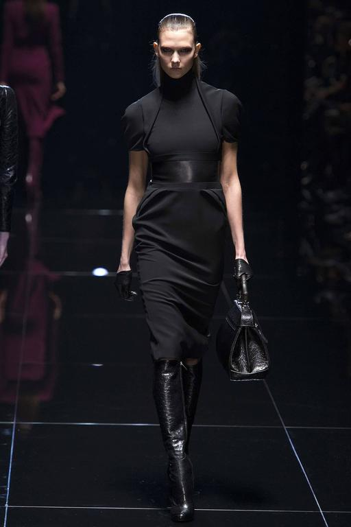 """Gucci Fall 2013 runway Black Dress with Leather Waist.  Tagged size IT 42 USA 6.  To fit 34"""" at bust, 29"""" maximum waist, 37/38"""" hip. Shoulder seams 14"""", sleeve 8"""", back neck seam to hem 41"""".  79% rayon, 19 wool, 2"""