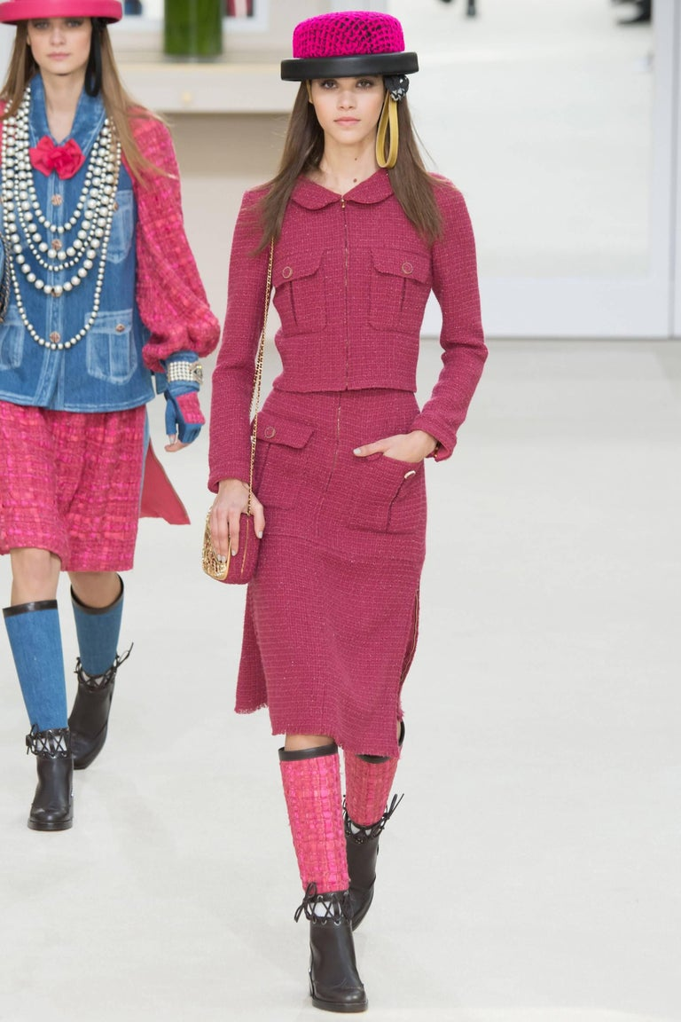 Chanel raspberry tweed wool skirt suit from the fall 2016 runway collection.  Original retail price $8825. Jacket has rounded collar, centre front goldtone zipper, and front chest pockets.  Skirt is high waisted and has goldtone zippers at centre