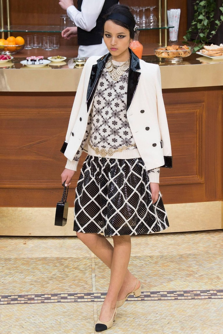 Chanel 15K Black Jacket with Patent Collar and Camelia Buttons.  Ivory version was shown on the Chanel 2015 fall runway as pictured. Original retail price of this jacket was $5700 USD.  Double row of enamelled camelia flower buttons and patent trim