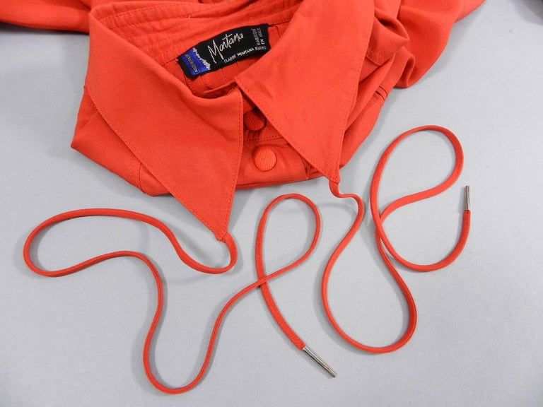"""Claude Montana 1980's Tomato reddish orange Shirt with String Collar.  Back of shirt has pin tucked design and garment fastens with snaps. Likely a size FR 36 or 38. Can fit size USA 2/4 as oversized or size 6. Garment measures 46"""" at bust, 44"""" at"""
