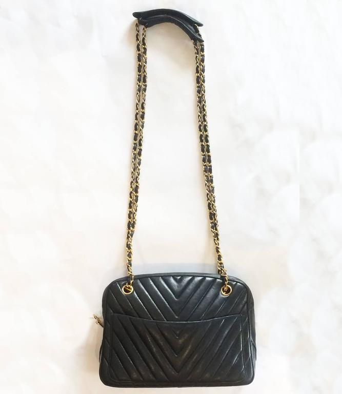 "Authentic Shoulder Bag by Chanel, in Black Matelassé Leather with ""V"" stitch and black leather threaded, gilt chain shoulder straps, with adjustable padded tops and adjustable/removable straps. Outer has a large pocket to both front and rear;"