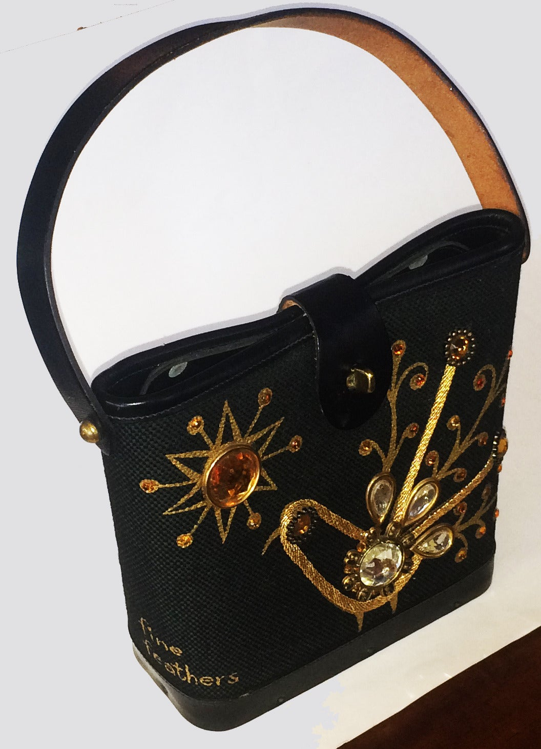 """Handbag, 1960's Enid Collins """"Fine Feathers"""", Jewelled fronted purse. Rare, """"stay shut"""", sprung top with heavy quality leather trim and loop clasp to swivel closure. Timber base and all in excellent condition. Interior has a gilt label, """"COPYRIGHT"""""""