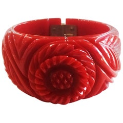 Art Deco heavily carved red clamper hinged bangle bracelet