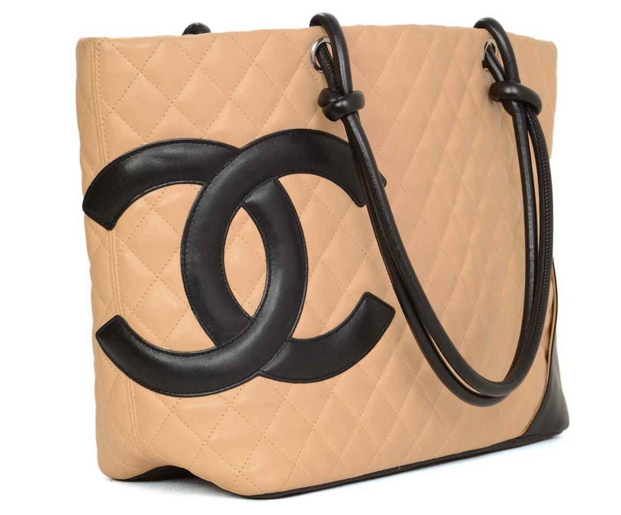 19b0f920ab88 CHANEL Tan/Black Quilted Leather Large Cambon Tote Bag Features interior  leather strap with lobster