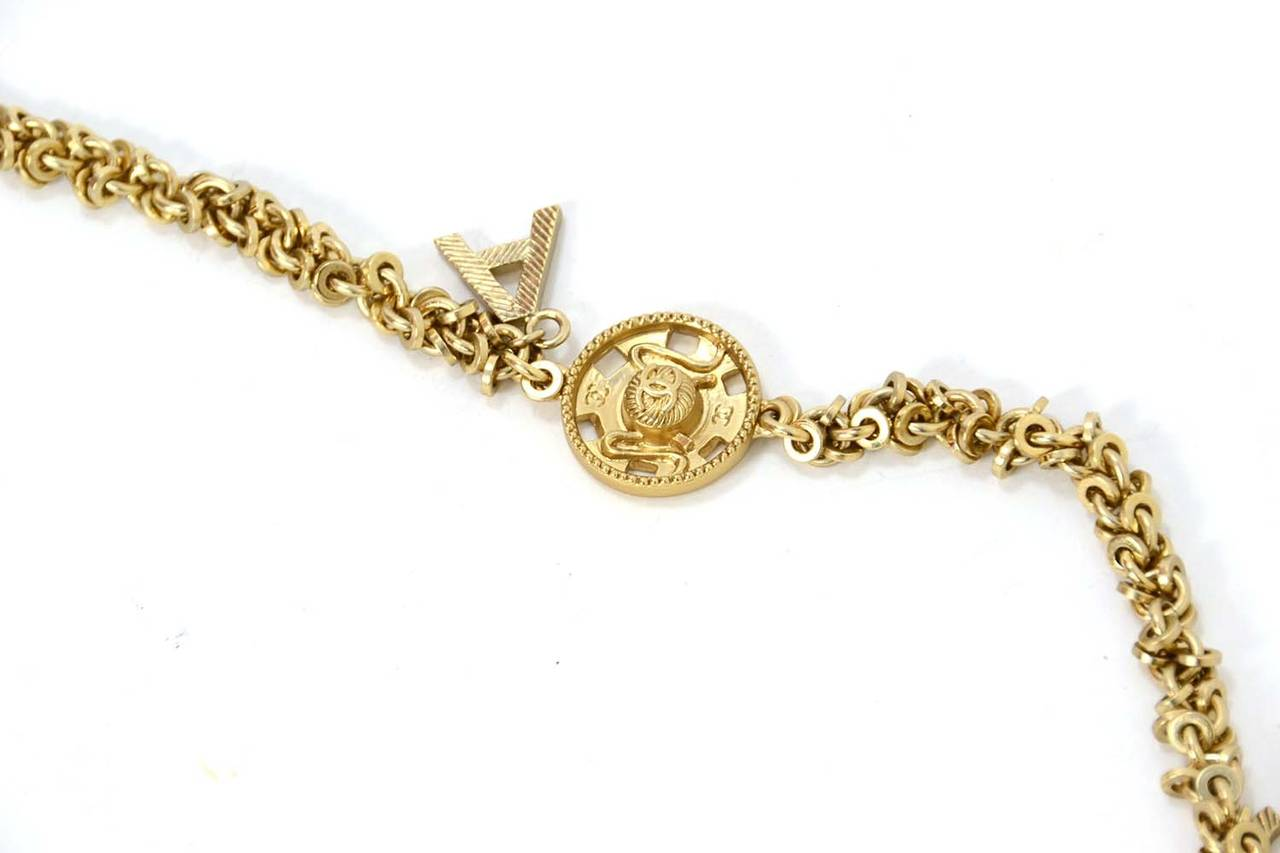 Women's Chanel 2003 Goldtone Chain Belt/Necklace w/ Seamstress Charms For Sale