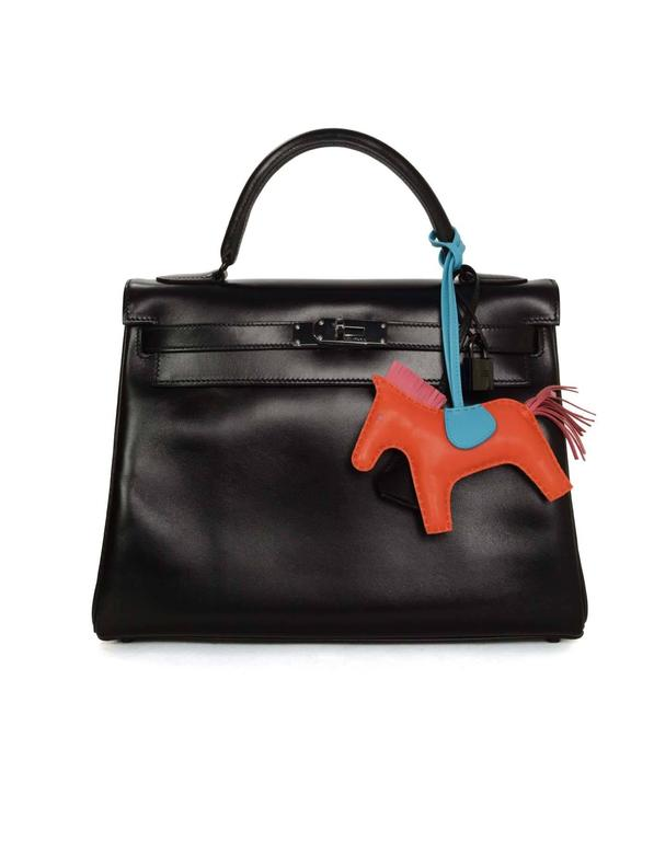 Hermes '16 Orange Poppy, Rose Azalea & Blue Izmir Rodeo Horse Charm  Made In: France Year of Production: 2016 Color: Orange pooppy, rose azalea and blue izmir Materials: Leather Closure/Opening: None Stamp: Hermes Paris Made in France Overall