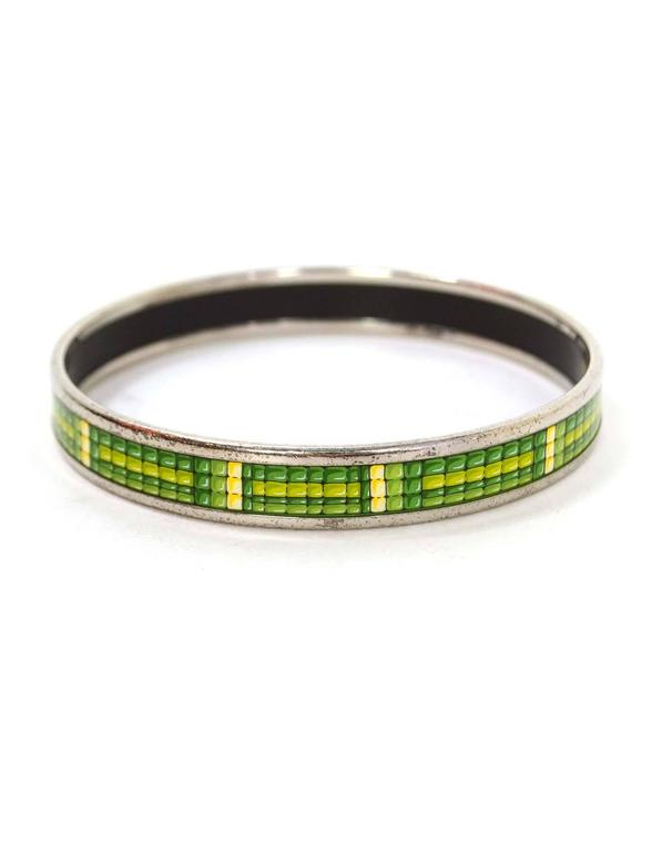 Hermes Narrow Printed Enamel Bangle  Features green and yellow tiles printed throughout Made In: Austria Color: Green, yellow, and silvertone Hardware: Palladium Materials: Enamel and metal Closure: None Stamp: Made in Austria + K Retail