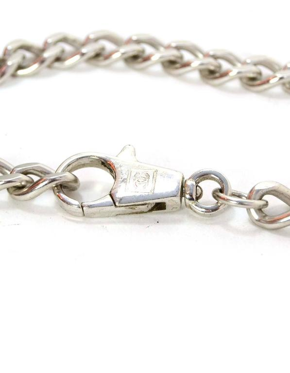 """Chanel Silver """"No 5"""" Chain Link Belt Features silver hardware """"No 5"""" pendant   Made In: France Year of Production: 2001 Color: Silvertone Materials: Metal  Closure/Opening: Hook closure Stamp: 01 CC P Overall Condition:"""