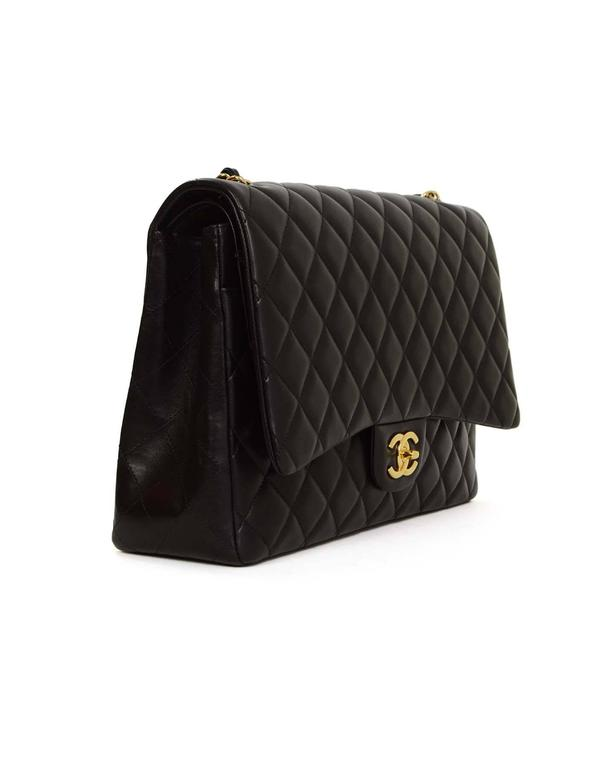 34afb9fd2580 Chanel Black Quilted Lambskin Maxi Classic Flap Bag GHW Features adjustable  shoulder strap and single flap