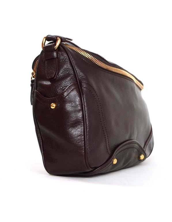 7bd2e90946 Celine Dark Burgundy Leather Zip Top Shoulder Bag Features one side with  wooden charm w