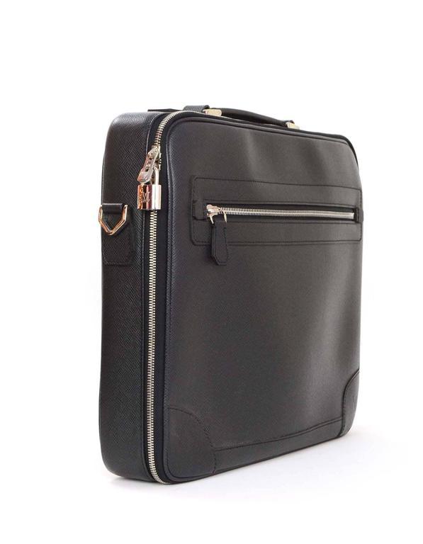e99ba878bf88 Louis Vuitton Black Taiga Odessa Messenger Bag Features a top handle with  adjustable straps Made In