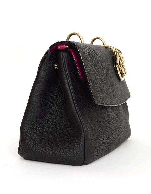 e63ecd70af94 Christian Dior Black Small Be Dior Bag Features Dior charm set on front of  bag