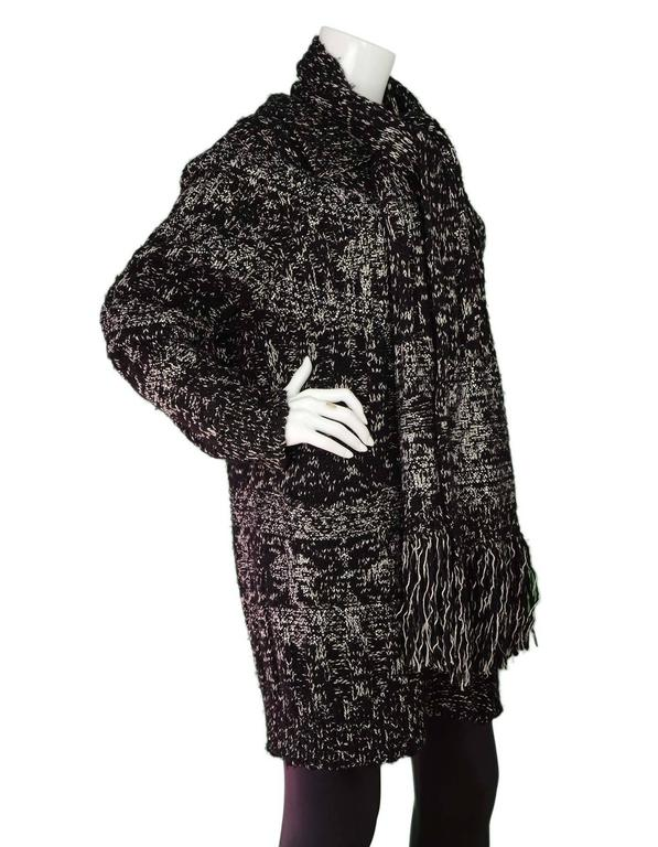 Chanel Black & White Chunky Knit Cardigan & Scarf Set  Both cardigan and scarf feature clear crystal details throughout Made In: Italy Color: Black and white Composition: 52% wool, 18% cashmere, 16% cotton, 7% paper, 3% silk, 3% polyester, 1%