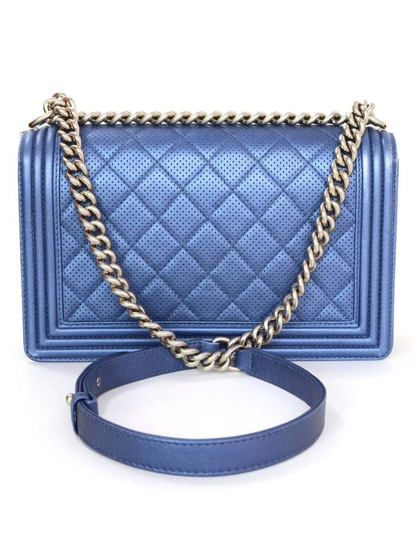 6c0157f9b819 Chanel Metallic Blue Perforated New Medium Boy Bag Features adjustable  shoulder strap and quilting throughout Made
