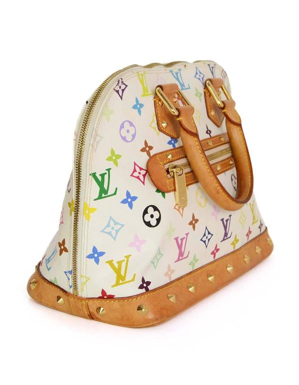645638a3102 Louis Vuitton Multicolore Monogram Alma Tote Features gold studs throughout  tan leather trim of exterior Made