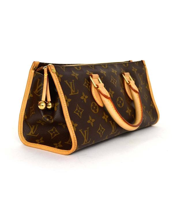 dad5d07f717 Louis Vuitton Monogram Horizontal Popincourt Top Handle Bag Features  leather trim throughout exterior Made In