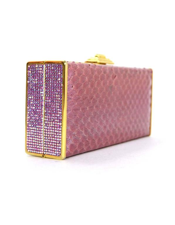 Judith Leiber Iridescent Pink Python & Crystal Minaudiere  Features pink Swarovski crystal trim throughout and optional goldtone chain link shoulder strap Made In: U.S.A Color: Iridescent pink and goldtone Hardware: Goldtone Materials: Python,