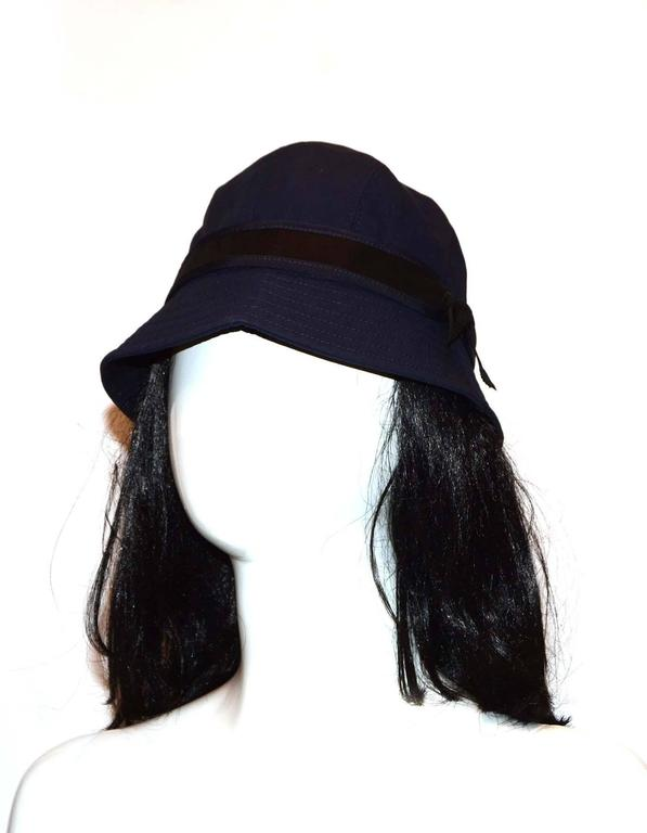 e85ab4b564612 Chanel Navy and Black Bucket Hat Sz 57 Features band with bow and CC detail  Color