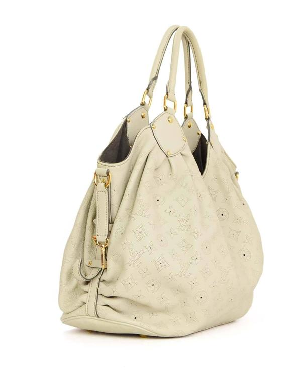 27235c6a93b6 Louis Vuitton Ivory Leather Perforated Monogram Mahina XL Hobo Bag GHW For  Sale. Features perforated monogram Made In  France Year of Production  2007  ...