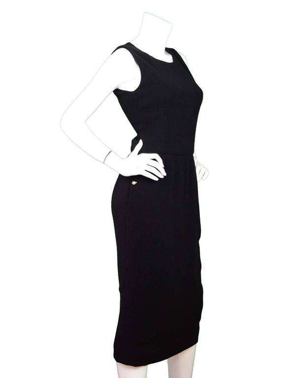 Chanel Black Sleeveless Long Dress  Color: Black Composition: Not listed, believed to be wool blend Lining: Black lining Closure/Opening: Back zip closure Exterior Pockets: Two side pockets with button detail Overall Condition: Very good