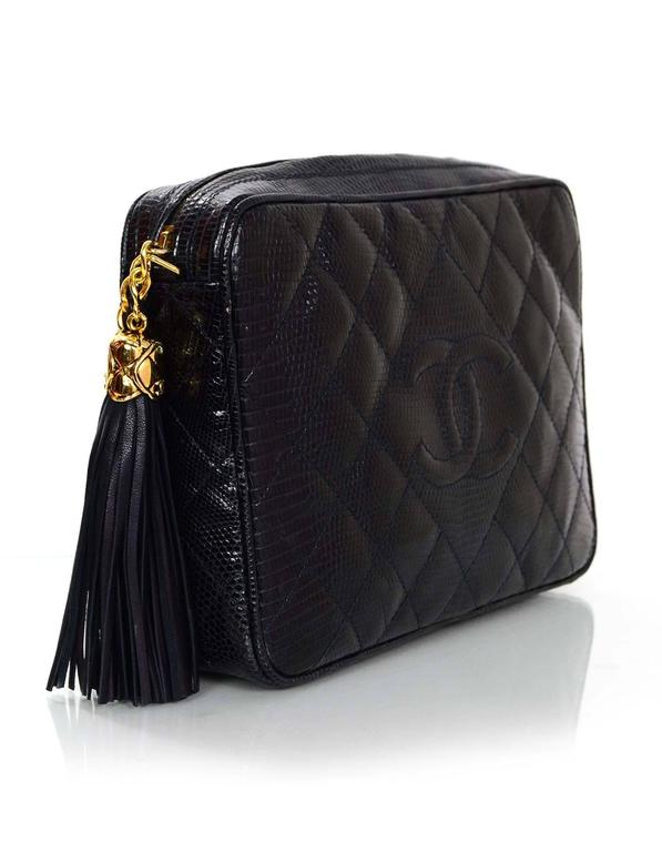 25b2b6404aec Chanel Navy Lizard Skin Camera Bag Features timeless CC at front and quilted  goldtone tassel zipper