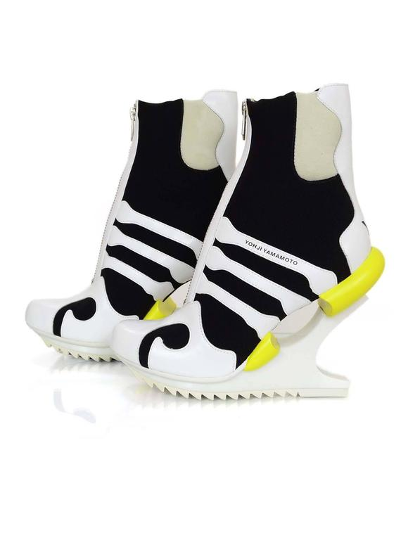 Adidas Y-3 by Yohji Yamamoto Oriah Sneaker Booties Sz 6  Made In: China Color: Black, white, yellow Materials: Canvas, leather Closure/Opening: Front zip closure Sole Stamp: Yohji Yamamoto Retail Price: $690 + tax Overall Condition: