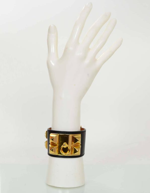Hermes Black & Gold Collier de Chien CDC Cuff Bracelet sz S  Made In: France Year of Production: 2013 Color: Black Hardware: Goldtone Materials: Leather and metal Closure: Stud and notch closure Stamp: Q stamp in square Overall Condition: