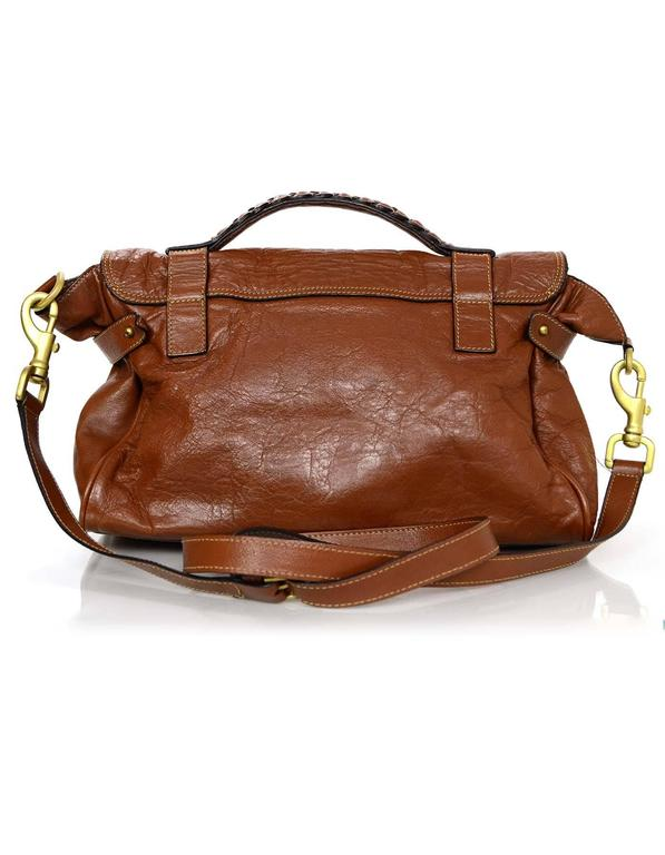 100% Authentic Mulberry Oak Leather Medium Alexa Satchel Bag. Features braided detail at handle and classic Mulberry twist lock. Optional long strap allows for crossbody use, making this a perfect everyday bag.  Made In: Turkey Color: