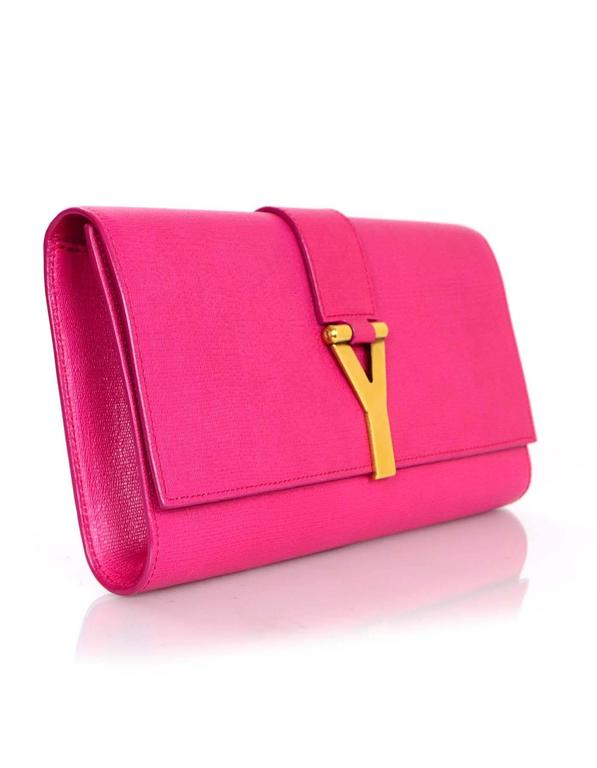 a11435fcd81 100% Authentic Yves Saint Laurent Pink Classic ChYc Clutch. Features flap  top closure with