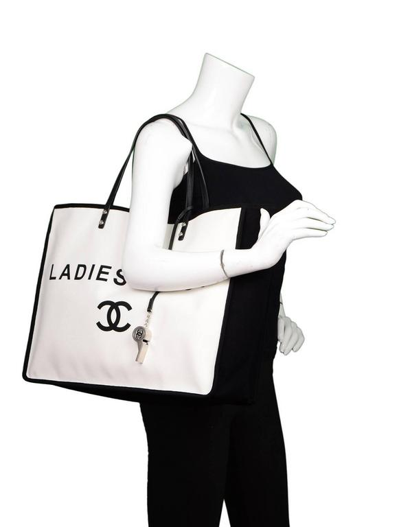 00c0466845cc Chanel Black and White Canvas Ladies First Tote Features 'Ladies First'  motif and whistle