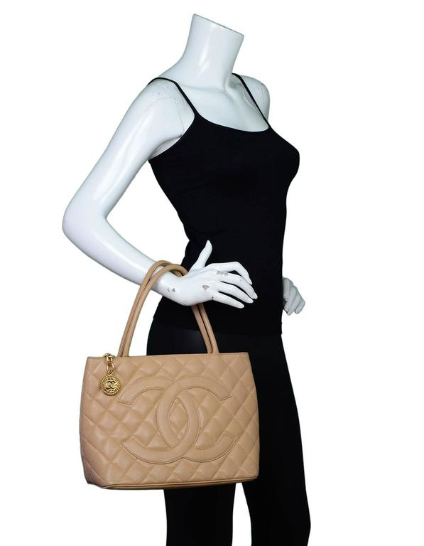 bbd1953346a3 Chanel Beige Caviar Leather Medallion Tote Features timeless CC at front  and quilting throughout Made In