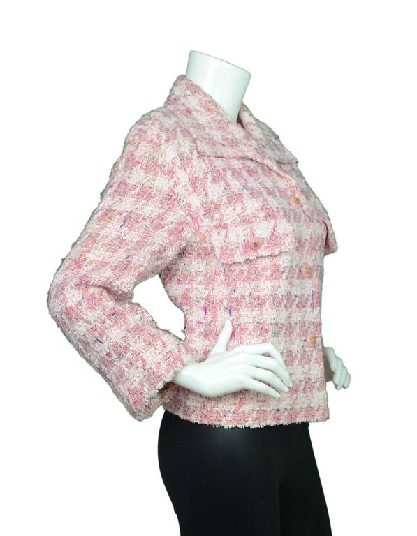 Chanel Pink Fantasy Tweed Jacket Features pink buttons with CC logo  Color: Pink, white Composition: Not listed, feels like cotton blend Lining: Pink textile Closure/Opening: Button down front Exterior Pockets: Two pockets at bust Interior