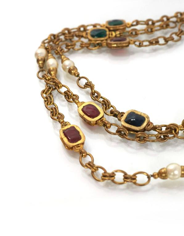Chanel Chain Link & Gripoix Long Necklace  Features faux pearl details throughout  Made In: France Year of Production: 1984 Color: Goldtone, ivory, red and green Materials: Metal, faux pearl and gripoix (poured glass) Closure/Opening: Push