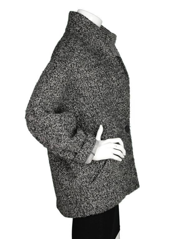 Isabel Marant Grey Boucle Dolman Sleeve Jacket  Made In: Slovakia Color: Charcoal grey Composition: 40% wool, 28% modal, 25% polyester, 7% cotton Lining: Grey, 100% cotton Closure/Opening: One snap button at waistline Exterior Pockets: Two hip
