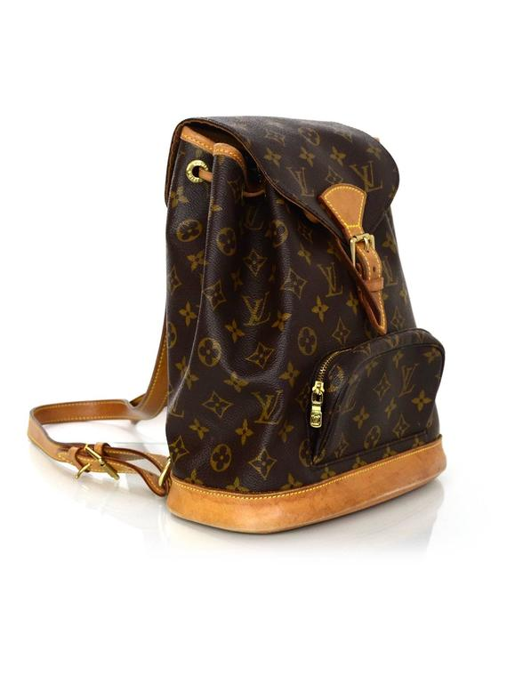 Louis Vuitton Monogram Montsouris MM Backpack Features leather trim throughout and adjustable shoulder straps  Made In: France Year of Production: 1997 Color: Brown Hardware: Goldtone Materials: Leather and coated canvas Lining: Brown