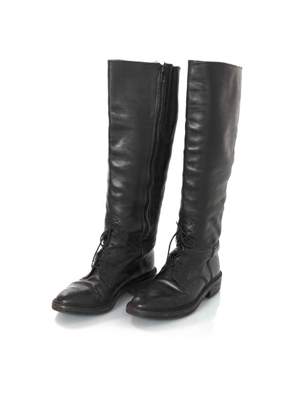 Chanel Black Leather Riding Boots Features CC stitched on toe cap and lace up detailing at front  Made In: Italy Color: Black Materials: Leather Closure/Opening: Side zipper and laces Sole Stamp: CC Made in Italy 38 Overall Condition: Very good
