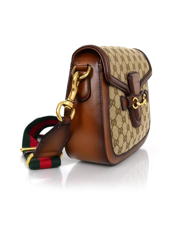 156951e43d2d 100% Authentic Gucci Brown Medium Lady Web Crossbody. Features brown  stained leather trim with