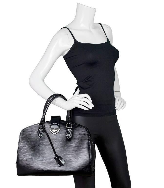 aab6d5e89844 100% Authentic Louis Vuitton Black Epi Leather Neuf GM Tote. Features black  patent Epi