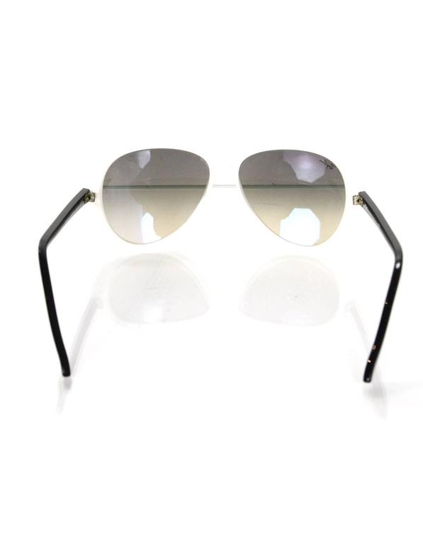 2fd3e5239a2 100% Authentic Ray Ban Black And White Aviator Sunglasses. Features plastic  white frame in