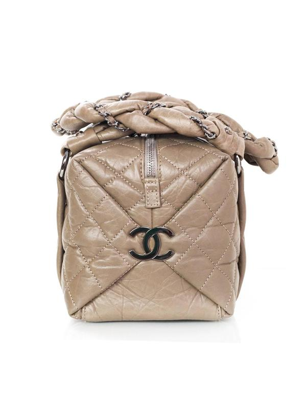 Chanel Etoupe Quilted Leather Lady Braid Bubble Bag  Features leather woven chain link details wrapped around shoulder straps and two large CC pendants on both side panels of bag Made In: Italy Year of Production: 2006 Color: Taupe Hardware: