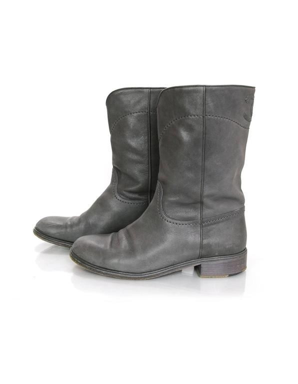 Chanel Grey Leather Calf-High Boots Features stitched CC at back of boot shaft  Made In: Italy Color: Grey Materials: Leather Closure/Opening: Pull on  Sole Stamp: CC Made in Italy 41 Overall Condition: Very good pre-owned condition with the