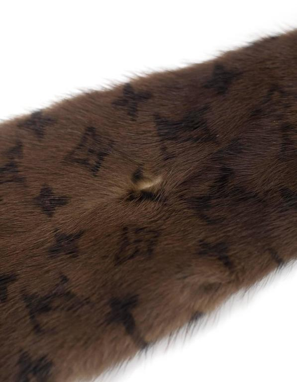 Louis Vuitton Brown Monogram Mink Fur Stole Features dark LV monogram design throughout  Made In: France Color: Brown Composition: 100% mink fur Overall Condition: Excellent pre-owned condition with the exception of faint perfume scent Measurements: