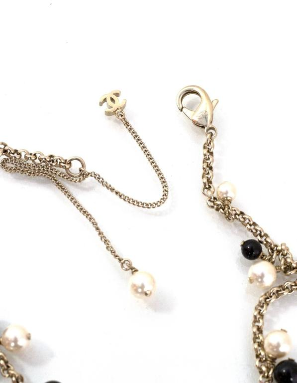 Chanel Pearl & Black Beaded & Iconic Charm Necklace In Excellent Condition For Sale In New York, NY